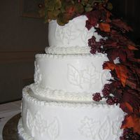 "Fall Wedding Cake This is my first wedding cake ever! 3 tiers - 12"", 9"", 6"". Buttercream frosting with white on white leaf piping. Silk..."