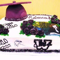Graduation Cake Hi this is a double layer 1/2 sheet cake, 1/2 white, 1/2 chocolate. Cake is buttercream except for the graduation cap, which is covered in...