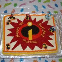 "Disney The Incredibles Birthday Cake This was for my oldest son's 4th birthday. He loved the Incredibles. I recreated the ""swirl"" freehand on the cake first and..."