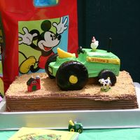 John Deere Tractor Oops, didn't mean to send the super close up..., tractor and tires are frosted (with yellow fondant accents).