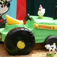 Tractor Cake  Finally did it, was actually pretty easy though didn't plan on the hot day and the long drive (the small tire fell off (that's...