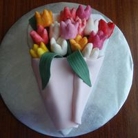 Bunch Of Tulips I made this cake last night for my cousins birthday.Its a chocolate mudcake. The icing,flowers and leaves are all MMF. I think that she...