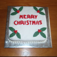 Christmas Cake This is a fruitcake that I made a several weeks ago. The icing and decorations are all fondant.I didnt use marzipan because no one likes it...