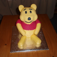Pooh Bear  This is my 1st attempt at a pooh bear cake.It was a challenge...I made it for my cousins birthday.I made it out of Madeira cake.First,I...