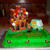 Haunted Birthday My 5 year old son designed this cake. The haunted house is the Wilton Halloween gingerbread kit. The mystery machine is fondant over...