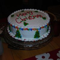 Merry Christmas Cake   This cake was done for my family. It has little christmas lights all around the top