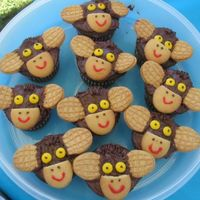 Monkey Cupcakes These were made to go with my son's Curious George birthday theme. They consist of nutter butter ears, vanilla wafer nose and mm eyes...