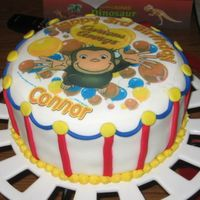 Connor's Curious George Birthday I purchased the edible image off ebay, all other decorations are fondant and BC for the yellow trim. I also made monkey cupcakes to go with...