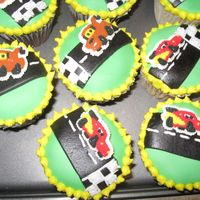 Disney Cars Fondant Cupcakes Cupcakes with fondant tops and store-bought cars cake decs.
