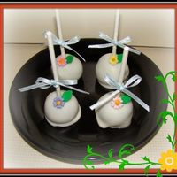 Cute Cake Balls Pops   Chocolate cake balls dip in white chocolate with fondand flowers