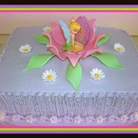 Tinkerbell In Flower 9X13X4 Buttercream icing with fondand flowers.