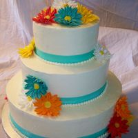 Gerbera Daisy Wedding  Gumpaste Gerbera daisies with Swiss Meringue buttercream. Cake flavors are marble cake with raspberry, lemon cake with lemon curd filling,...