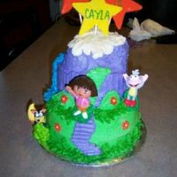 Dora Star Mountain   White velvet cake with strawberry filling and frosted with vanilla buttercream and fondant accents.