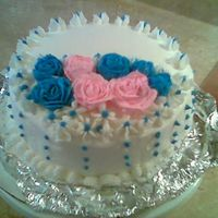 Roses Practice Cake- Course 1 Lesson 2 I'm practicing my roses. They were quite difficult for me. I think my frosting was too soft because they kept falling over. ?? any...