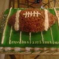 Super_Bowl_Cake.jpg super bowl cake with a rice crispy football on top