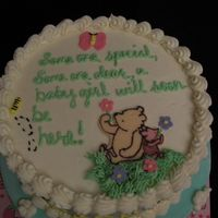 "Top Of Classic Pooh Baby Shower Cake The top reads, ""Someone special, someone dear, a baby girl will soon be here!"""