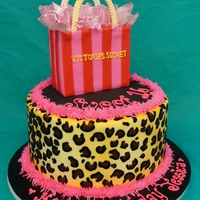 "Sweet 16   9"" BC cheetah print with a 4"" x 4"" victoria secret bag. wafer paper tissue airbrushed with pink shimmer colour."