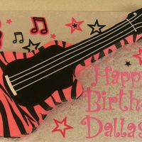 Dallas's Guitar   made from a 11x15 cake, buttercream with fondant stripes. Letters cut with the cricut