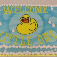 Rubber Ducky 9x13 cake, Light blue buttercream airbrushed with bubbles and waves, Cricut cut letters.