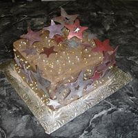 Starry Night! This cake was for a family reunion. The stars are made from candy melts and dusted with luster dust