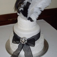 3 Tier Wedding Cake With Ribbon, Brooch And Feathers