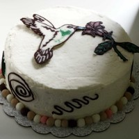 Humming Bird Cake Mocha cake with seedless raspberry filling and IBC frosting. The humming bird and other decorations are made from melted chocolate. The...