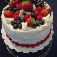 Sponge With Fresh Summer Fruit And Whipped Cream scratch sponge - 2 layers. Each layer soaked with cherry brandy simple syrup, fresh strawberries and blueberries and topped with whipped...