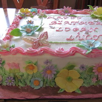 Flowers And Butterflies Vanilla cake with strawberry cream filling, buttercream frosting with fondant flowers and white and pink chocolate butterflies