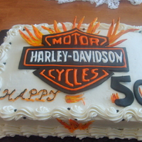 Harley Logo 50 birthday cake with gum paste Harley logo.Cake was a Toasted Butter Pecan can with butter cream frosting.