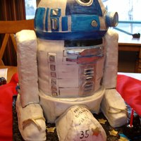 R2D2 My First Big 3D cake.Chocolate cake peanutbutter cream filling,Yellow cake raspberry cream filling.The legs are crispy cereal.covered and...