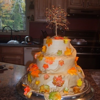 Fall Cake Hand Painted Leaves This was a fall wedding cake. The bride requested peanut butter frosting and wanted drape to match. I used LorAnne peanut butter flavoring...