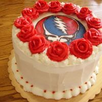 "Grateful Dead Grooms Cake Made as a surprise for a friend's fiance, who is a ""deadhead"". Yellow cake with whipped chocolate ganache filling and BC..."