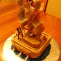 Piratecake.jpg Birthday cake for a friend's 9 year old son. Yellow cake with chocolate BC icing. This is the third cake that I've made for...