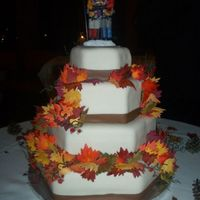 Fall Wedding Cake This is a four-tier three-layer wedding cake. Tiers alternate in flavor, bottom is white cake, top is dark chocolate. Each tier is covered...