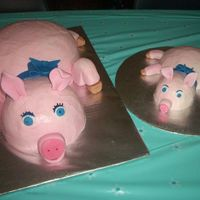 Barnyard Birthday Piggies! This is a single-tier three-layer white cake decorated with dyed vanilla buttercream frosting. Each layer of the cake is covered in a...