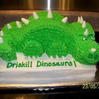 Dinosaur End of year party with class mascot theme. Base 11 x15. Dinosaur is made from halved 8 inch round, small doll skirt (head) and carved (tail...