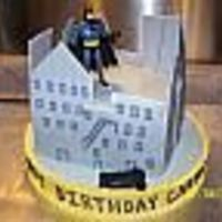 "Batman In Gotham City 10"" square chocolate cake. Buttercream icing with MMF buildings. Batman action figure and car added. I'm sorry I don't..."