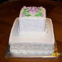 Wedding Shower Bottom tier white chocolate, top, strawberry. Buttercream icing and MMF rose buds and leaves.