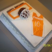 Ut Basketball Cake 9X13 Buttercream with MMF accents. Ball is mini ball pan.