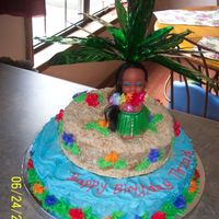 "Hula Girl Birthday cake for little girl. Bottom tier 12"" top, 8"". Buttercream icing, crushed vanilla wafers for sand. Hula girl and tree..."