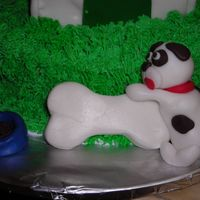 Close Up Of Puppy I molded this puppy out of fondant using Debbie Brown's instructions in her 50 Easy Party Cakes book.