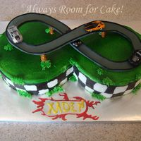 Race Track Race track cake. Track made out of gumpaste, cars are mini hot wheels. Rest of the cake is buttercream. I got this ideas from a few cakes...