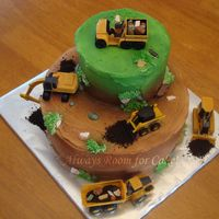 Construction Construction cake for my son's birthday. The construction vehicles are toys, the rocks are chocolate, the dirt is oreos. The rest is...