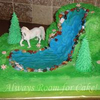 "Unicorn And Waterfall 11x15 cake with a 6"" and 8"" stacked on top for the waterfall. All buttercream airbrushed, unicorn is a toy, trees are sugar cones..."