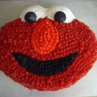 Elmo Cake I thought this would be a fun cake to do. All buttercream, it was really hard to get the black so black. My husband helped me by dumping...
