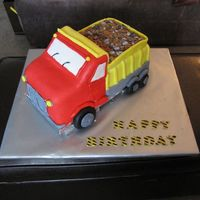 Dump Truck Birthday Cake I made this cake for two little boys' birthdays. Hand carved cake, covered with buttercream and MMF. All MMF detils, candy rocks and...