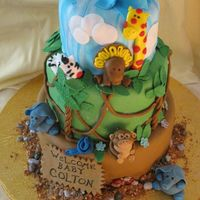 Safari Baby Shower Cake All fondant covered cakes as well as the animals and baby and other details. Gumpaste sign and leaves, graham cracker and brown sugar &quot...