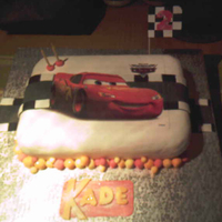Lightning Mcqueen Fruit cake was supplied and I was asked to do the rest.