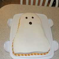 Ghost Cake   Quick cake I did to take to my sons school. All buttercream and I used candy corn around the edges.