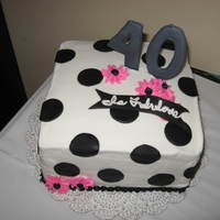 40 Is Fabulous This was done for a good friends 40th BDay. Buttercream icing, the numbers were done in color flow, and the polk-a-dots are fondant.